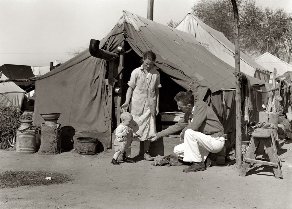 Migrant workers lived in tents in Weedpatch Camp, California. California archive photo