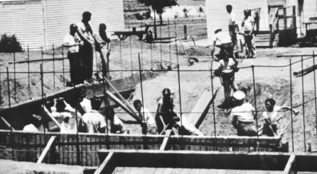 Students building swimming pool ~ Photo from Arvin Federal Emergency School