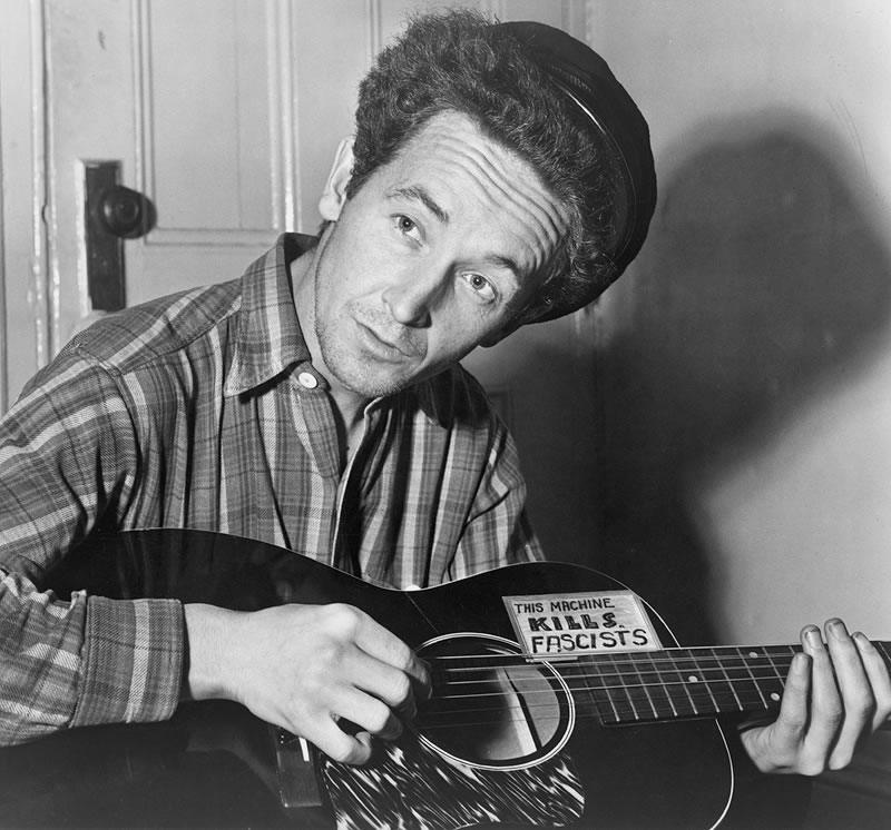 Woody Guthrie. March 1943. Credit: Al Aumuller, The Library of Congress, Prints & Photographs Division